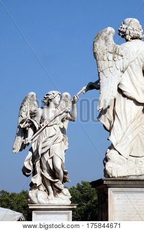 ROME, ITALY - SEPTEMBER 03: Statue of Angel with the Lance by Domenico Guidi, Ponte Sant Angelo in Rome, Italy  on September 03, 2016.