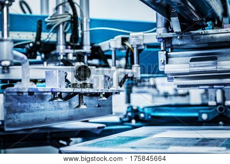 Screen printing machine. Metal industrial machinery.