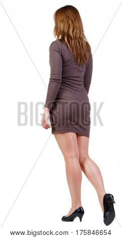 back view of going brunette girl in dress. beautiful woman in motion.  backside view of person. Isolated over white background. Rear view people collection.