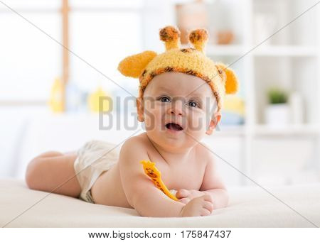 happy infant baby child in giraffe costume