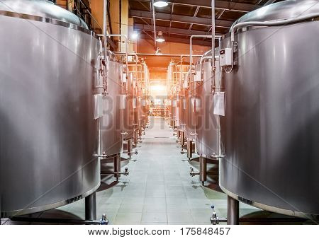 Rows Of Steel Tanks For Beer Fermentation And Maturation.