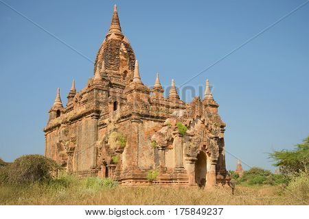 Ancient Buddhist pagoda close up on a sunny day. Bagan, Myanmar
