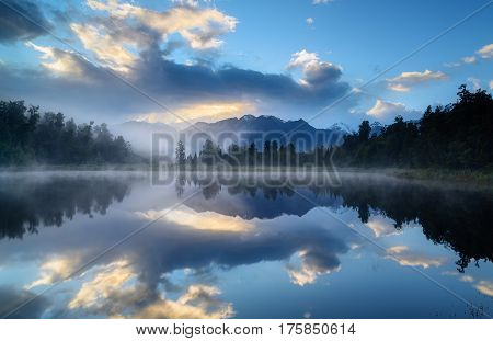 Reflections at Lake Matheson on early morning South Island New Zealand