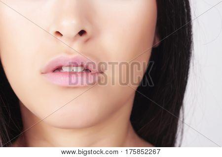 Closeup shot of beautiful young woman. Skin care concept.