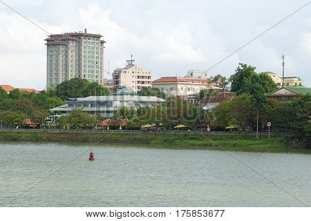 HUE, VIETNAM - DECEMBER 15, 2015: Modern Hue in the cloudy afternoon. The urban landscape