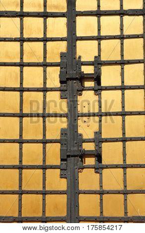 Old metal golden door padlock with iron forged.