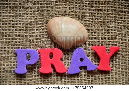 word pray on a  abstract colorful background