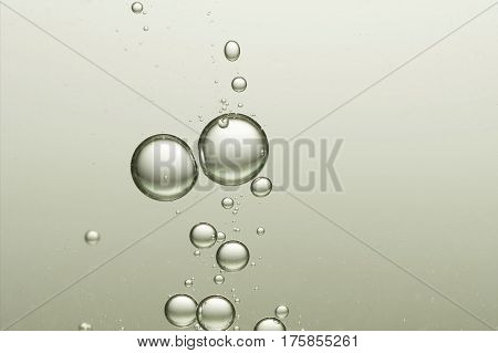 Flowing fizz bubbles over a light grey background