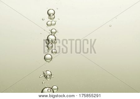 Many round air bubbles flow toward the survace