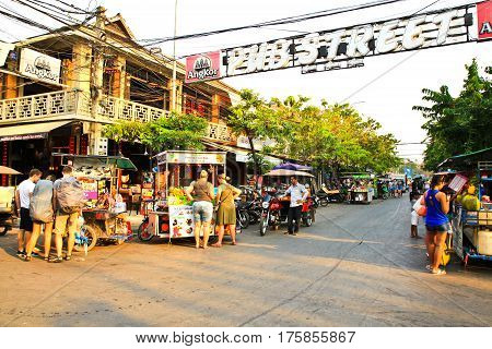 SIEM REAP CAMBODIA - MARCH 02 2017: A lot of unidentified tourists stroll along Pub Street. It is famous with plenty of restaurants and located in the heart of the tourist area.