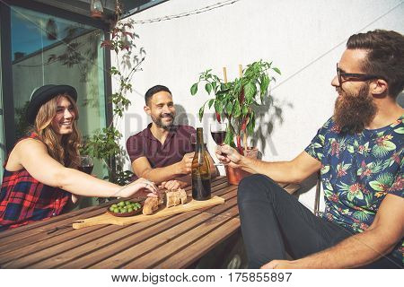 Bearded Man Toasts With His Friends And Smiles