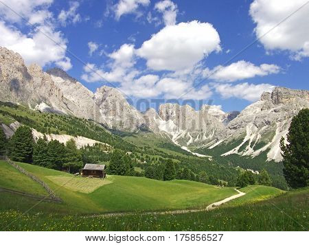 house fence in valley on high mountain blue sky view in dolomites dolomiti dolomiten Italy
