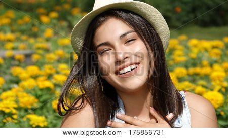 Teen Girl In Love Sitting in Meadow of Flowers