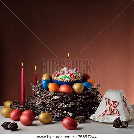 Traditional Russian-Orthodox Easter (Paschal) food: Easter bread cheese cake Paskha painted eggs
