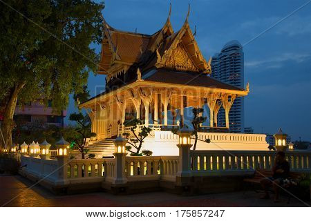 BANGKOK, THAILAND - JANUARY 04 2017: Old wooden Buddhist temple in the Santi Chai Prakan park in the evening twilight