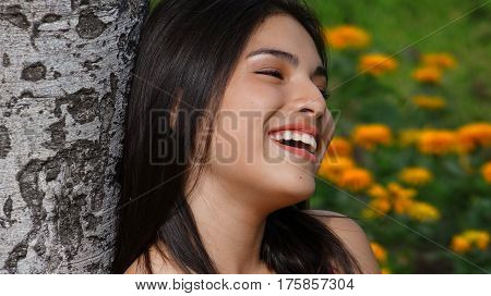 Happy Teen Girl In Love and Sitting in Park