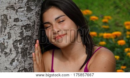 Female Teen Daydreaming and Sitting in Park