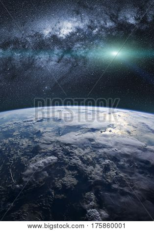 A fantasy view of the planet Earth with the milky way in background and shiny stars in the sky.