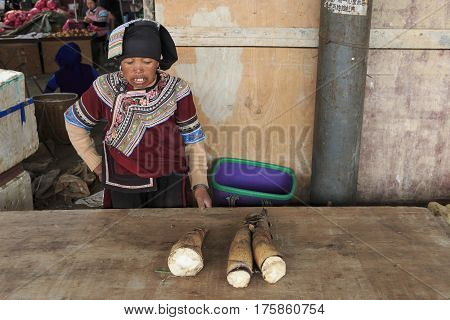 Yuanyang, China - February 21, 2017: Hani Woman Selling Bamboo In The Shengcun Local Market In Yuany