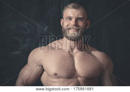Portrait Of A Handsome Guy On A Background Of Gym