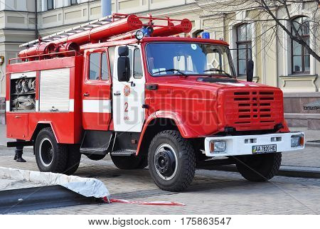 KIEV UKRAINE - March 14 2017:  Red colorful firetruck Kraz ride on call fire suppression