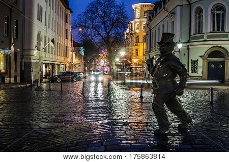 TALLINN, ESTONIA - JANUARY 29, 2017: Lucky Chimney Sweeper Sculpture. The sculpture by the Estonian sculptor Tauno Kangro was unveiled on May 15, 2010 near the cinema theater Soprus in Tallinn Old Town.