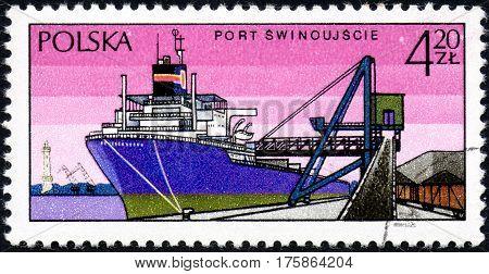 UKRAINE - CIRCA 2017: A stamp printed in POLAND shows port Swinoujscie and chip circa 1971