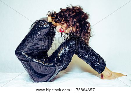Angry model woman confined in black foil