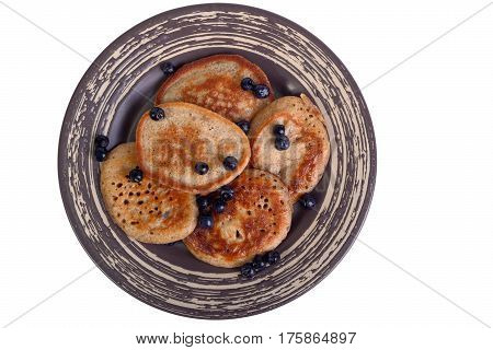 Wholegrain flour fritters with bilberry on a plate isolated on white