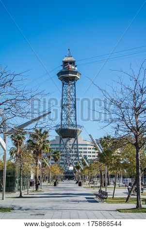 BARCELONA SPAIN - FEBRUARY 12 2014: A park in Barcelona and a cable car station on the background Spain.