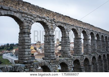 A View To Famous Ancient Roman Aqueduct Of Segovia And Old Buildings Of The Town, Castille And Leon,