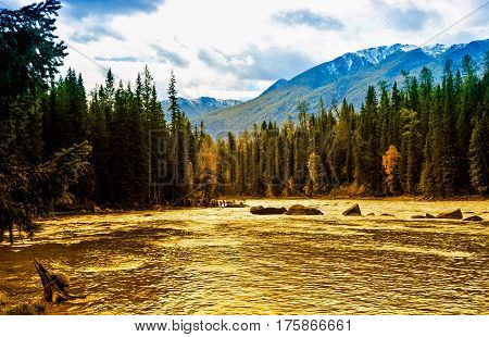 This photo is captured in China Xinjiang, Is a national nature reserve. This river is called Kanasi river, orginated from Kanasi Lake.