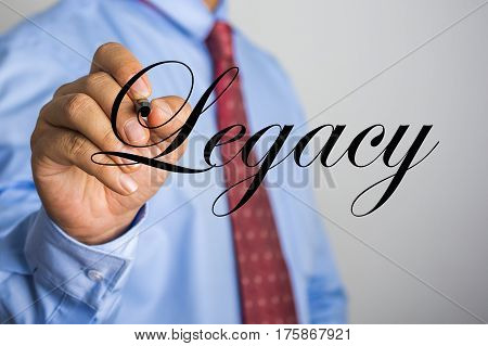 Businessman Writing Legacy Word On Virtual Screen