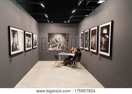 MILAN ITALY - MARCH 10: People visit MIA international photography and moving image art fair on MARCH 10 2017 in Milan.