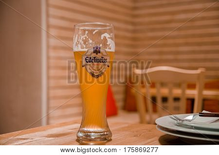 VIENNA AUSTRIA - SEPTEMBER 6 2012: One Pint of Edelweiss Weissbier in Vienna`s Pub