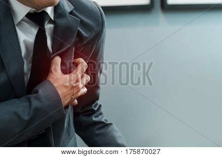 Close up Businessman in grey suit has heart attack. Exhausted Illness disease tired concepts.