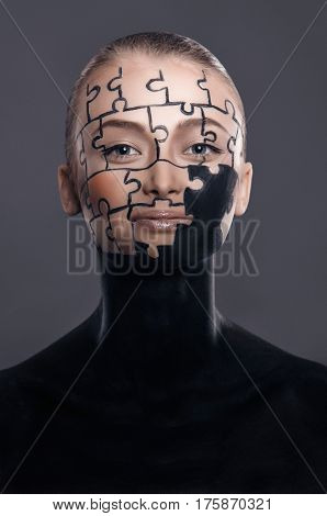 puzzles painted on a beautiful woman's face