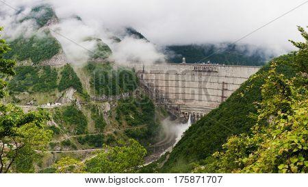 Enguri hydro power plant with morning fog in Georgia