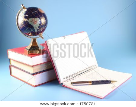 The Globe, Books And A Writing-Book On A Blue Background