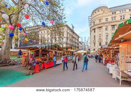 BUDAPEST HUNGARY - APRIL 13 2016: Tourists and visitors on Vaci Utca street the main pedestrian thoroughfares and perhaps the most famous street of central Budapest on April 13 2016. Budapest
