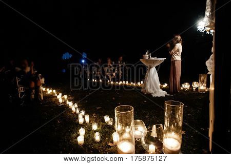 Woman Emcee Perfoming Speech For Evening Wedding Ceremony In The Garden