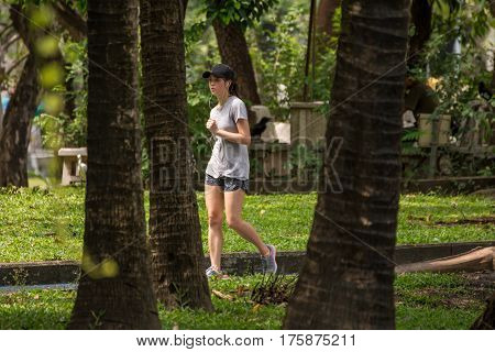 Bangkok Thailand - February 25 2017 : Unidentified woman jogger her jogging run on road runner in a outdoor park for exercise healthy
