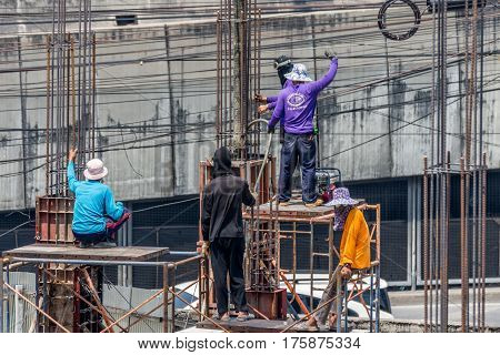 Bangkok Thailand - March 2 2017 : Unidentified construction worker mixing a concrete cement for building a builder at construction site.