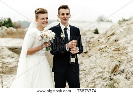 happy bride and groom toasting with champagne luxury wedding celebration hilarious moment