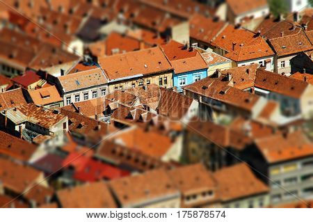 Rooftop tilt shift view of a European city. Brasov Transylvania Romania