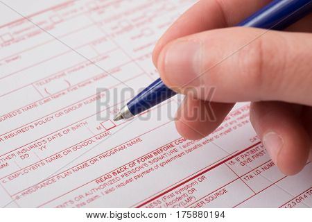 Health insurance claim form filled with pen