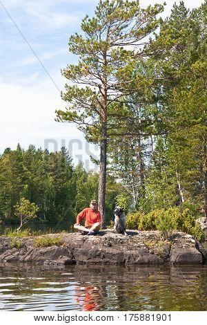 The man with the English setter on the island. Tagasuk lake. Krasnoyarsk Territory.