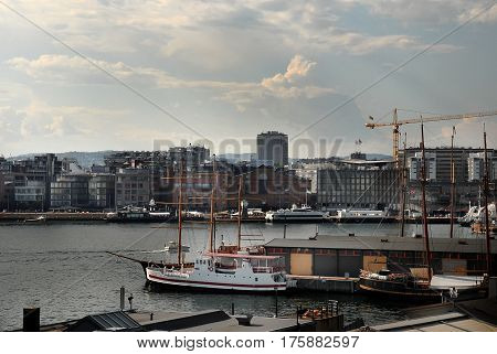 View of the Oslo's harbour promenade Norway. The Oslo Norway harbor is one of Oslo's great attractions. Situated on the Oslo Fjord the harbor front is a popular destination for tourists.