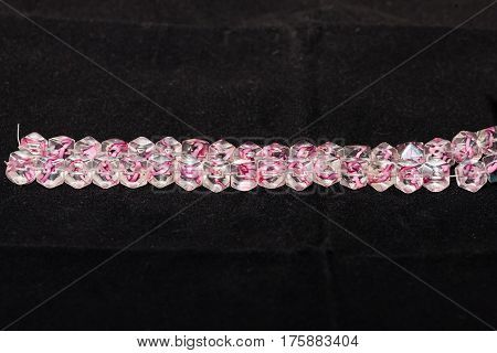 A strand of beads that will be used to craft various types of jewelry - 37