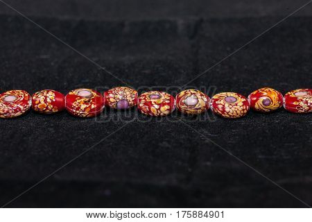 A strand of beads that will be used to craft various types of jewelry - 27